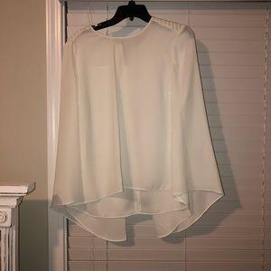 White cape-like blouse
